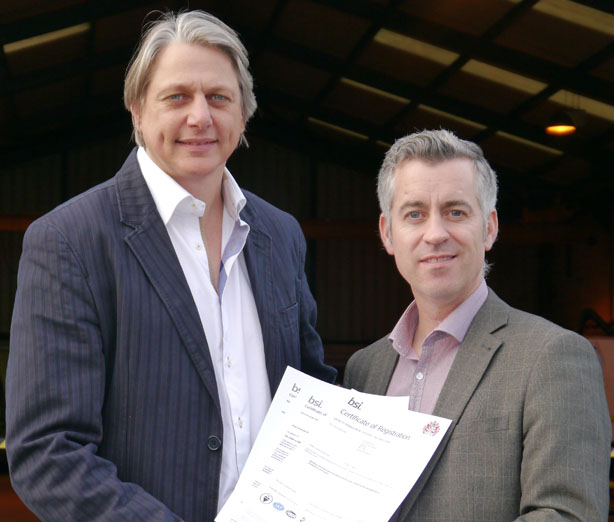 Cimpina Managing Director Robert McCarroll receiving a BSI Certificate of Registration from Tony Duff of Acheson Associates (on behalf of BSI)